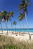 Young people dancing salsa at beach, Playas del Este, Havana, Ciudad de La Habana, Cuba, West Indies