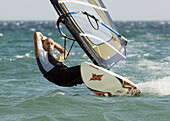 Ability, Action, Adult, Board, Equipment, Exciting, Male, Man, Ocean, Sail, Sail boarding, Sailboarding, Sailing, Sea, Sport, Wetsuit, Windsurf, Windsurfer, Windsurfing, A75-807073, agefotostock