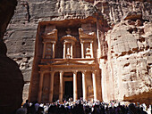 visitors at the Canyon and El Khazneh the Treasury temple at the UNESCO World Heritage Site Al Siq. ancient Nabataean rock city of Petra,  Jordan, Middle East.