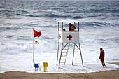 Red Cross lifeguard chair on Zurriola beach, San Sebastian. Guipuzcoa, Basque Country, Spain