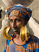 Peul woman wearing traditional gold earrings. Taikiri quarter, Mopti. Niger inland delta, Mali