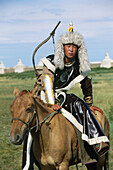 Rider dressed for a festival commemorating the 800th birthday of the mongolian empire. Erdene Zuu monastery. Kharkhorin. Mongolia