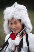 Tsaatan children dressed with reindeer skins Reindeer herders festival Jankhai Khovsgol lake Mongolia