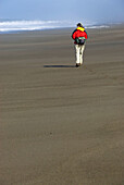 Hiking on beach, New River Area of Critical Environmental Concern, Coos Bay Bureau of Land Management District, Oregon, USA