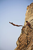 Cliff diver, a clavadista, diving off the cliffs at La Quebrada, Acapulco, Guerrero State, Mexico