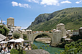 Stari Most, Old Bridge, following reconstruction, tourists, and Neretva River, Mostar, Bosnia Herzegovina, Former Yugoslavia