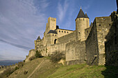 Architecture, Aude, Carcassonne, Color, Colour, Daytime, Europe, Exterior, Fortress, Fortresses, France, Historic, Historical, History, Horizontal, Languedoc-roussillon, Medieval, Outdoor, Outdoors, Outside, Rampart, Ramparts, Stronghold, Strongholds, Tow