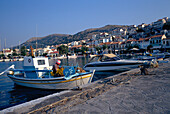 Boats and houses around harbourside, Pithagorio Harbour, Samos Island, Greek Islands