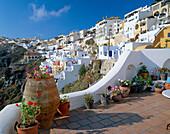 View of Hillside Town over patio, Fira, Santorini Island, Greek Islands
