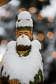 Snow-covered wooden figure, christmas market, Annaberg-Buchholz, Ore mountains, Saxony, Germany