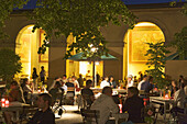 Guests sitting in Cafe Tambosi in the Hofgarten, Munich, Bavaria, Germany