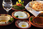 Mezze, bowls filled with appetizers and bread, Hilltop restaurant, Cairo, Egypt, Africa