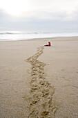Child crawling over the beach, Punta Conejo, Baja California Sur, Mexico