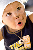 Portrait of a 14 month old girl that has been playing in the sand and looks excited, Punta Conejo, Baja California Sur, Mexico