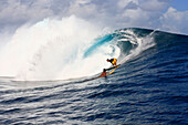 View to a barreling wave with a surfer, Teahupoo, Tahiti, French Polynesien, South Pacific