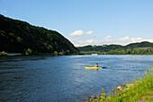 Man kayaking on Danube river, Passau, Lower Bavaria, Bavaria, Germany