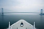 Bow of the cruise liner Queen Mary 2 leaving New York City, Verrazano Narrows Bridge, USA