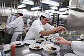Chefs preparing the starter in the galley, ships kitchen, cruise liner, Queen Mary 2