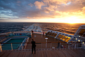 Passengers watching the sunset, Passengers on the afterdeck, Cruise liner, Queen Mary 2, Transatlantic, Atlantic ocean