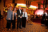 Captain Christopher Rynd with passengers in the Queens Room, Cruise liner, Queen Mary 2