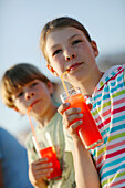 Girl and boy with fruit Juice, Formentera, Balearic Islands, Spain