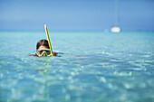 Girl snorkeling in the sea, Formentera, Balearic Islands, Spain