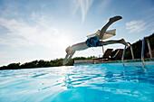 Boy diving into the pool, pool, Las Dunas Playa, Formentera, Balearic Islands, Spain