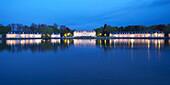 Illuminated Benrath Castle in the evening, Duesseldorf, North Rhine-Westphalia, Germany