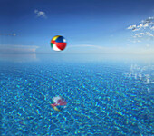 Beach ball above the water of an infinity pool, Bohol, Philippines, Asia