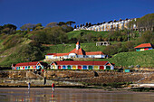 Colourful beach huts along South Cliff, Scarborough, Yorkshire, UK, England