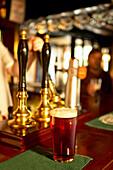 Pint of beer on pub bar counter, Beer, Food & Drink, UK, England