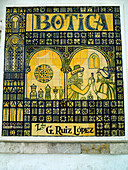 Pictorial mosaic sign on chemist shop, Cordoba, Andalucia, Spain