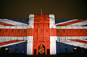 Buckingham Palace illuminated with Union Jack Flag at night, London, UK, England