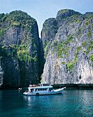 Pleasure boat in front of steep cliffs, Phuket, Ko Phi Phi Island, Thailand
