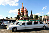 Luxury cars in front of St Basil's Cathedral, Moscow, Russian Federation