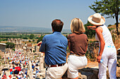 Tourists looking at Roman site, Ephesus, Aegean, Turkey