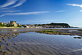View across South Bay beach with rippled sand, Scarborough, Yorkshire, UK, England