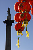 Chinese New Year, red lanterns and Nelsons Column, London, UK, England