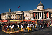 Chinese New Year, dragon dance in front of National Gallery, London, UK, England