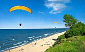 Beach scene with paragliders, Gdansk, near, Poland