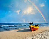 Beach scene with boat and rainbow, Gdansk, near, Poland