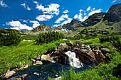 Scenery with mountain stream in Gasienicowa Valley, Tatra Mountains, Poland