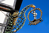 Wrought-iron Roland sign on half-timbered house, Quedlinburg, Saxony-Anhalt, Germany