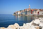 Old town over rocky shoreline, Rovinj, Istria, Croatia