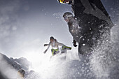 four young people jumping throw the snow, Kuehtai, Tirol, Austria