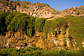 View at waterfall with calcareous sinters, Barranco de los Molinos, Parque Natural de Betancuria, Fuerteventura, Canary Islands, Spain, Europe
