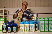 Managing director Juan Rodriguez Marrero with Aloe Vera products, Valles de Ortega, Fuerteventura, Canary Islands, Spain, Europe