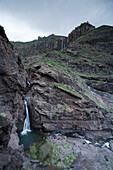 Waterfall above the lagoon Charco Azul in the mountains, Valley of El Risco, Parque Natural de Tamadaba, UNESCO Biosphere Reserve, West coast, Gran Canaria, Canary Islands, Spain, Europe