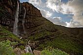 Waterfall Cascada el Escobar under clouded sky, El Risco valley, Parque Natural de Tamadaba, Gran Canaria, Canary Islands, Spain, Europe