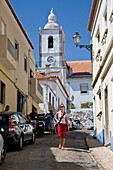 Young women in an alleyway in Lagos, church, MR, Lagos, Algarve, Portugal